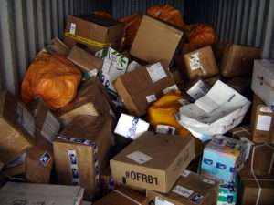packages thrown in truck - damaged goods